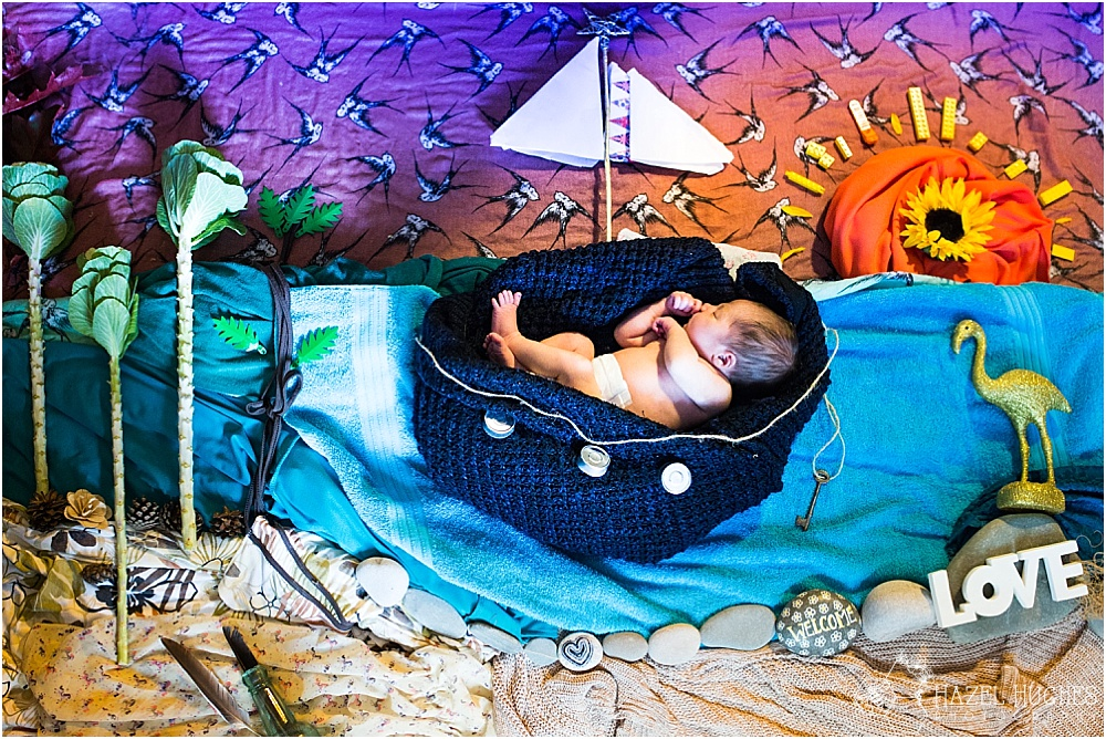 Newborn photography art sailing in a boat